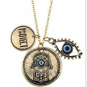 Gold hamsa, evil eye & protect charm necklace